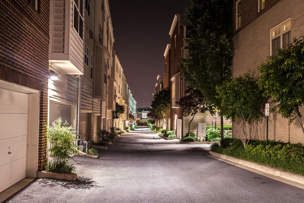 An image of Night light illustrate on the street of Private Drive and Cobble Hill Terrance Condo Buildings.